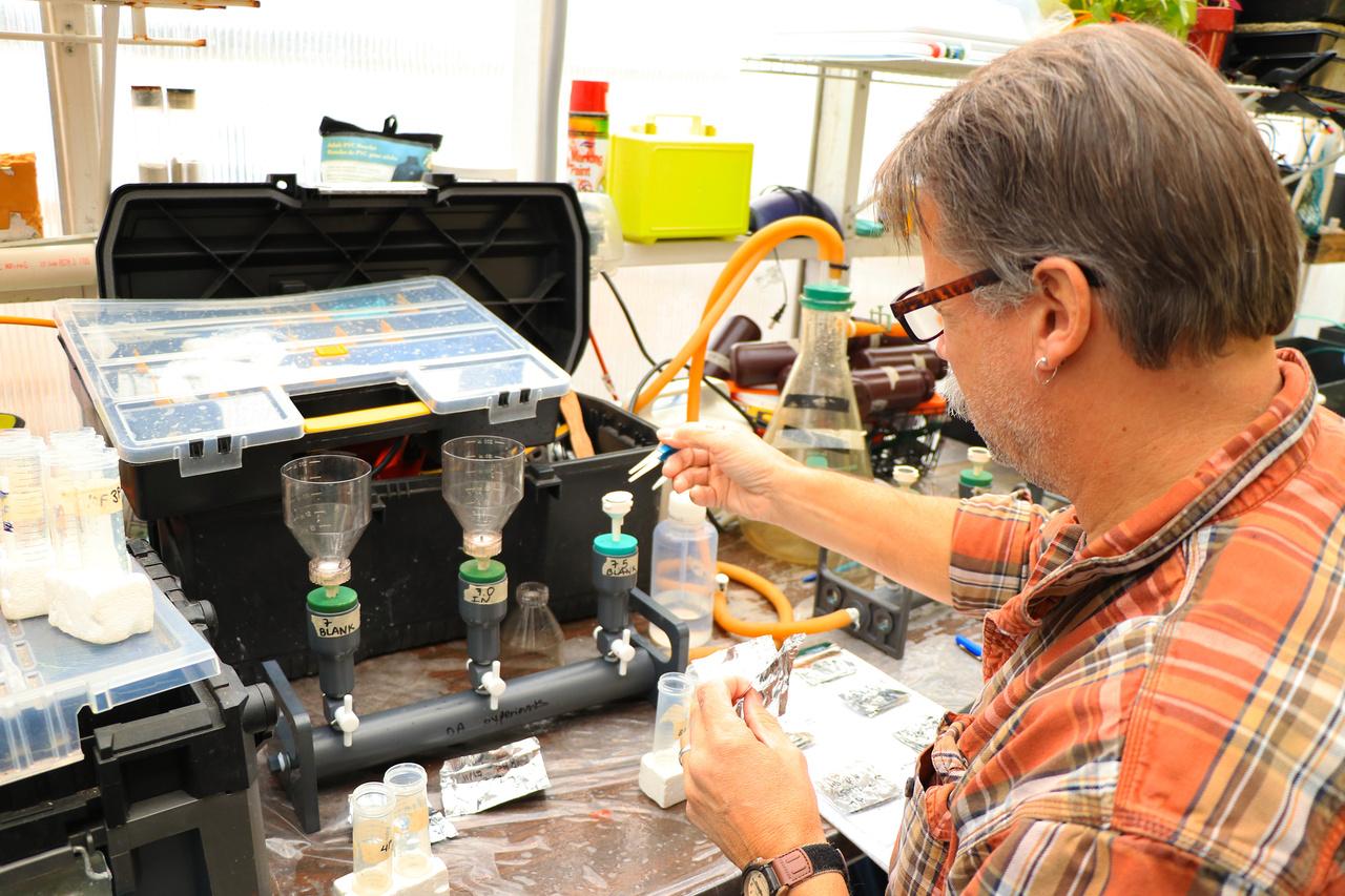 scientist filtering water samples in lab