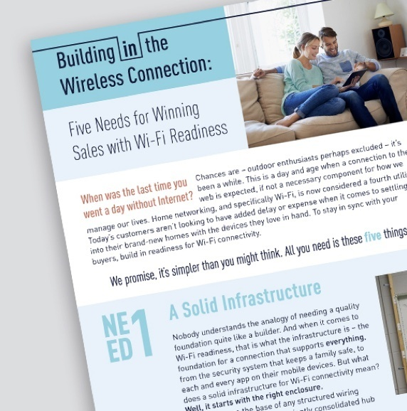 Cover of Legrand Wi-fi readiness whitepaper showing couple sitting on beige couch on the cover
