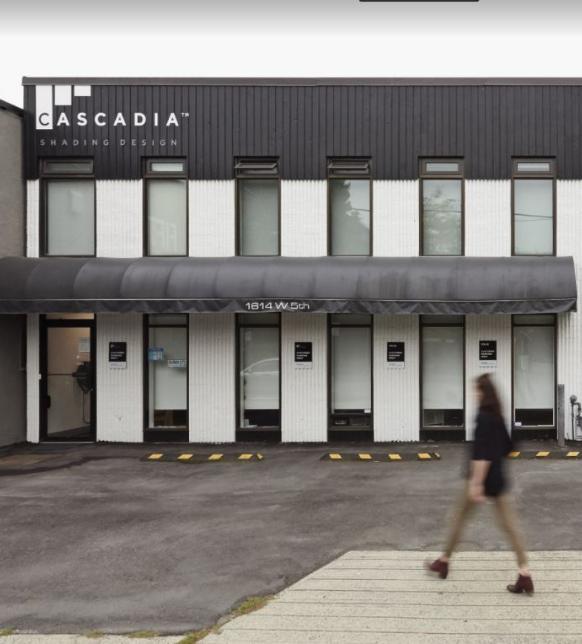 Woman walking toward the Cascadia Shading Design, Ltd. building
