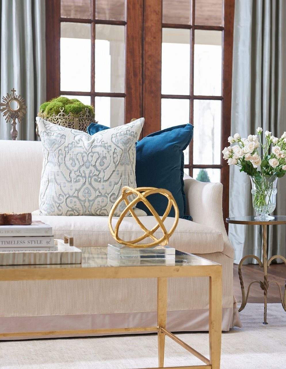 A linen sofa from Lee Industries has a timeless silhouette; the designer can change out pillows to give the room a new look.