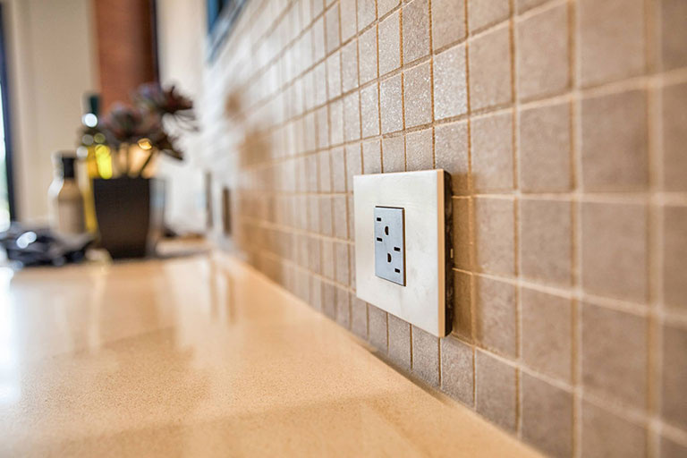 adorne Tamper Resistant Outlet above kitchen counter in backsplash