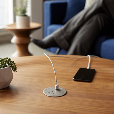 Coffee table with round furniture power center charging phone
