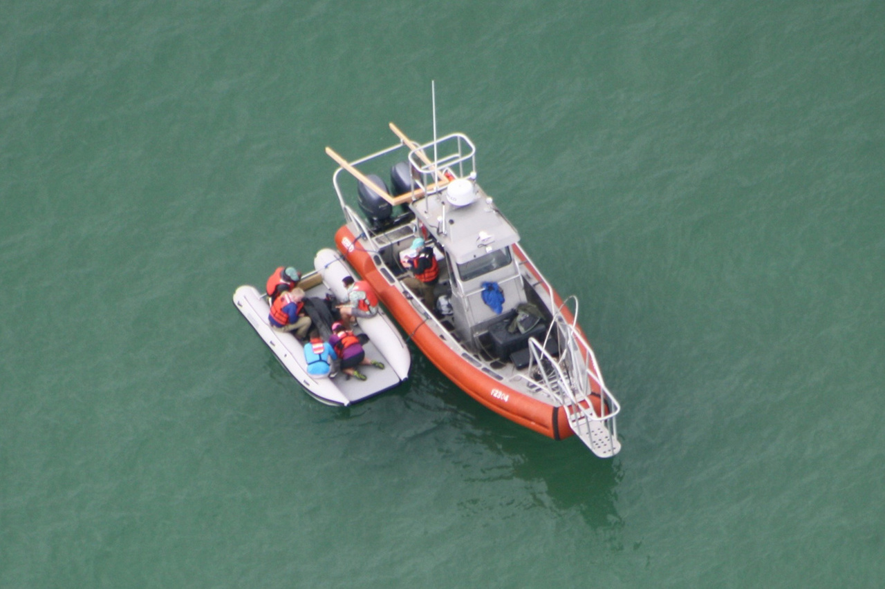 aerial view from plane of capture vessel and open catamaran