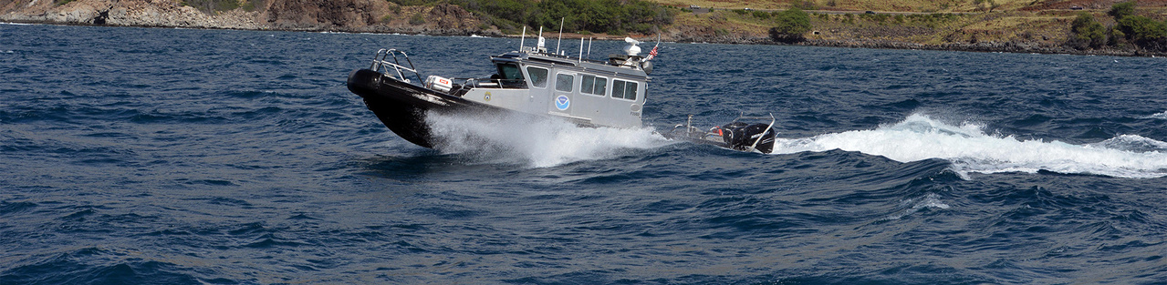 A NOAA law enforcement boat patrols offshore Maui