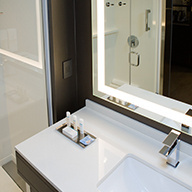 White modern wink with lighted mirror