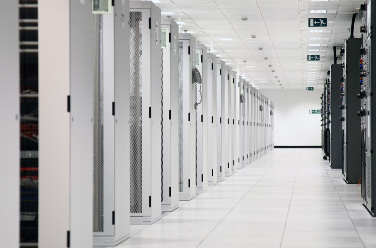 Desktop image of data center with white cabinets