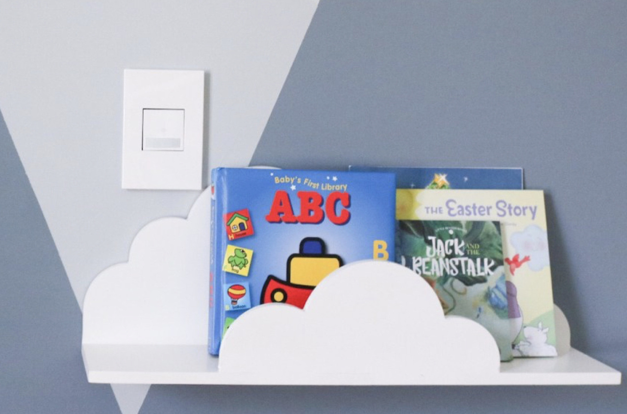 white adorne switch and wall plate in blue nursery