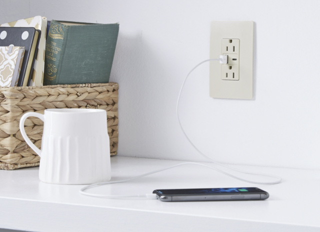 Light almond fast charging USB with phone charging on counter