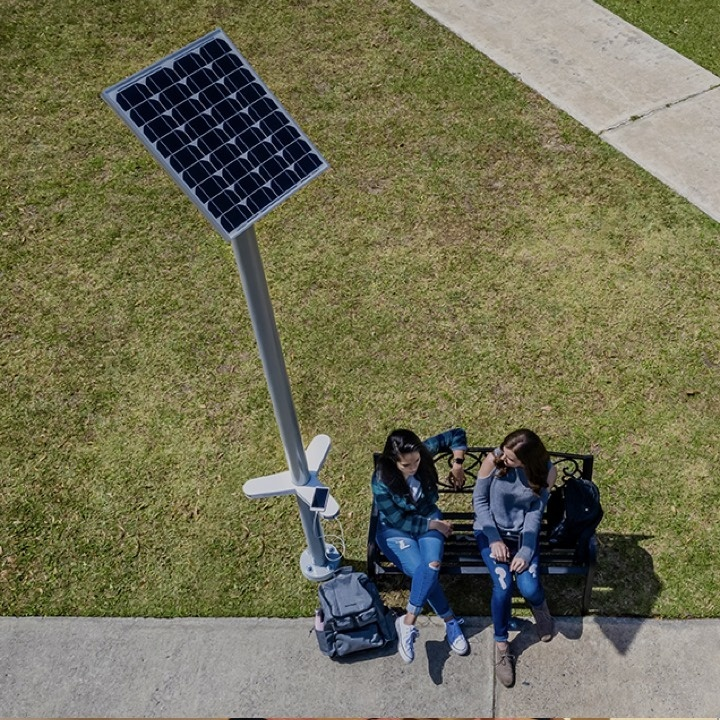 Solar charging kit installed next to park bench