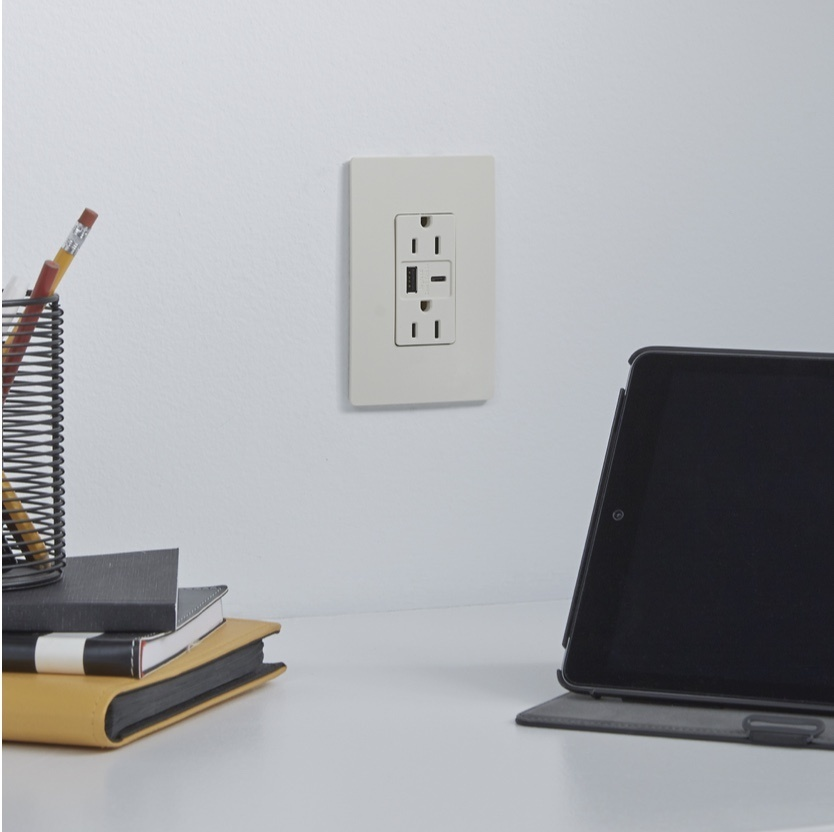 Off white outlet against white wall in office with USB A and USB C charging