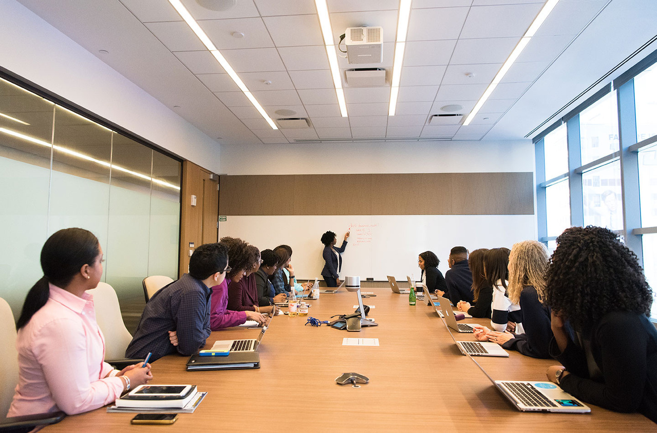 People at conference table in office space