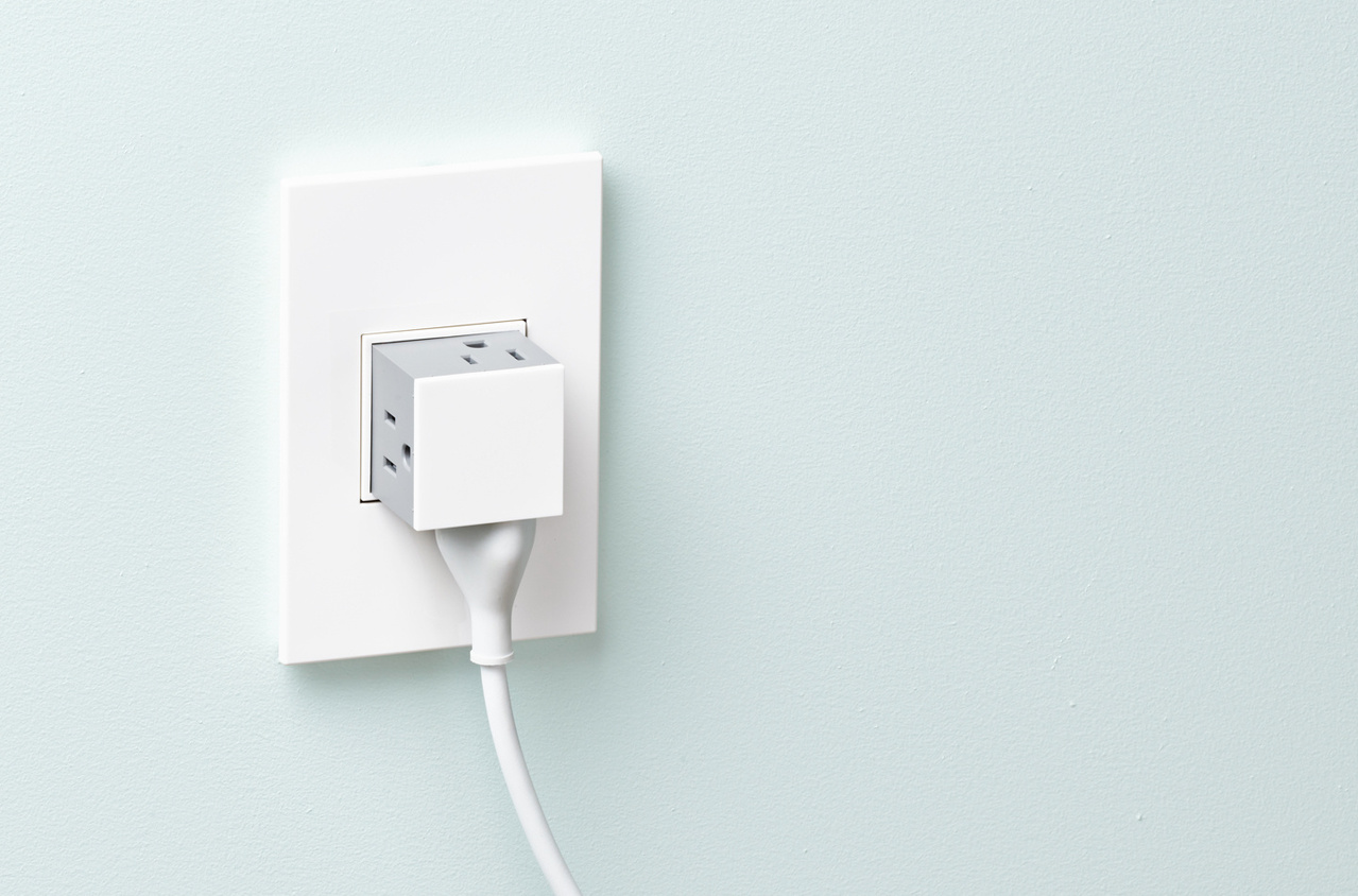 white adorne pop-out outlet against blue wall