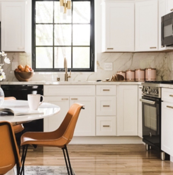 white kitchen with retro chairs