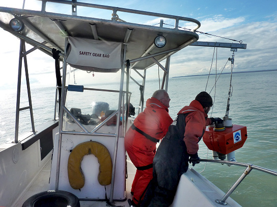 NOAA Fisheries scientist Manuel Castellote deploying the mooring package near the mouth of the Little Susitna River in Alaska in September 2016, with help from Dave McKay of McKay Yacht Charters, Anchorage.