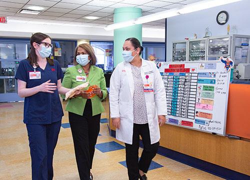Bernadette Khan with nurses at NYP Morgan Stanley Children's Hospital