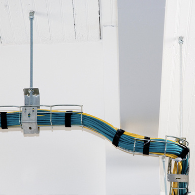 Overhead cable management system installed in commercial space ceiling