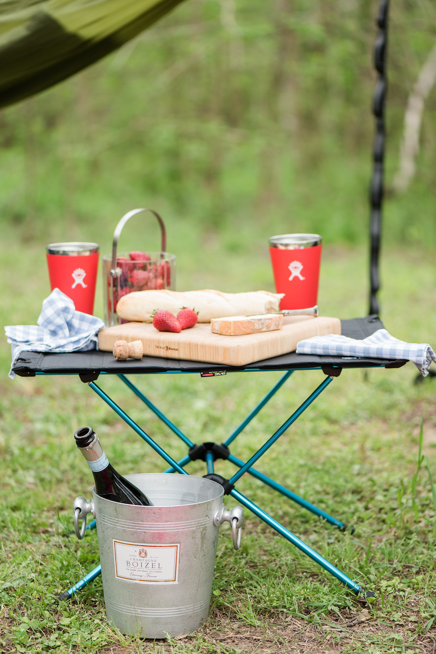 Bring your favorite glamorous appetizers to kickoff the campfire. Set them on this light, durable and collapsible Helinox camp table, $99.95, from Alabama Outdoors.