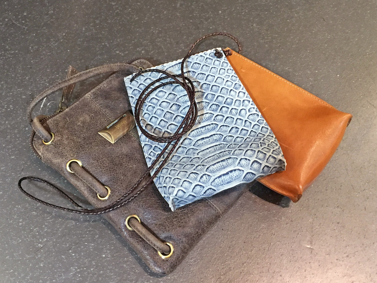 From Betsy Prince: Latico leather crossbody bag, $117; B. May leather cell pouch bags, $120
