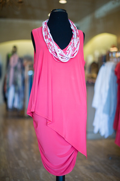 From Coming Attractions: Clare Sunwoo asymmetrical V-neck dress in geranium, $147; Shreds multistrand fabric necklace, $42