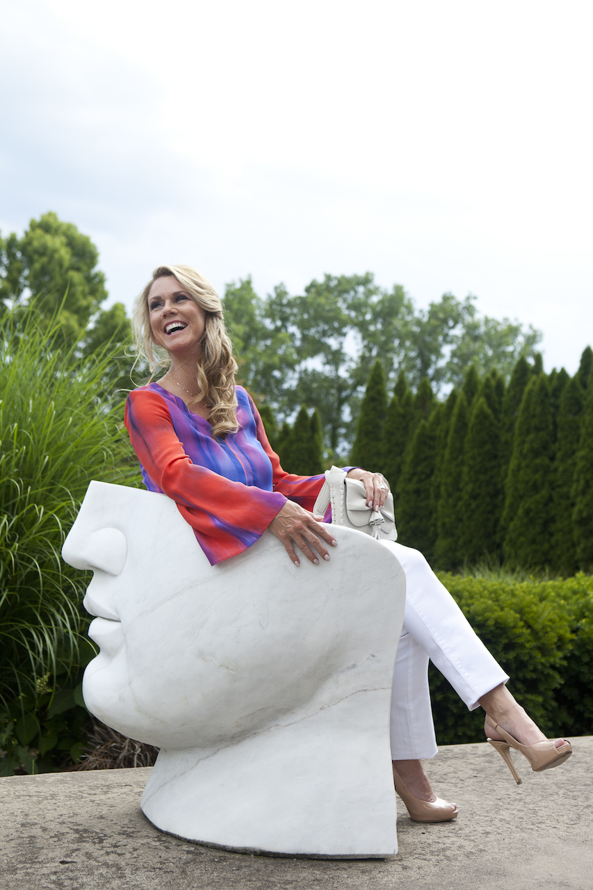 Arnita Ozgener for StyleBlueprint, wearing white jeans and a blouse found at Gus Mayer.