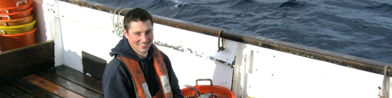 Fisheries observer on deck of commercial fishing boat.