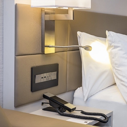 adorne Collection by Legrand designer light switches, outlets and USB charging outlets installed in hotel headboard