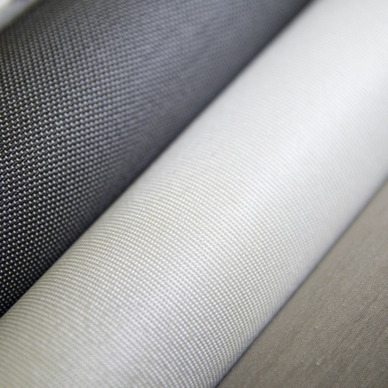 Close up of gray, white, and beige shading fabrics