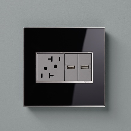 adorne Collection standard 20 amp outlet next to two half-size USB outlets in designer Mirror Black wall plate