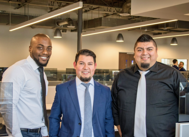 Three businessmen smiling