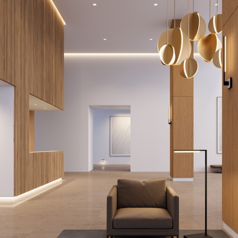 Sitting area with wooden walls & light fixtures and brown chair