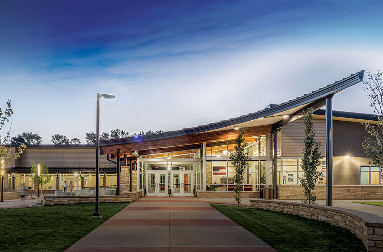 The external of a high school building with Kenall lighting fixtures