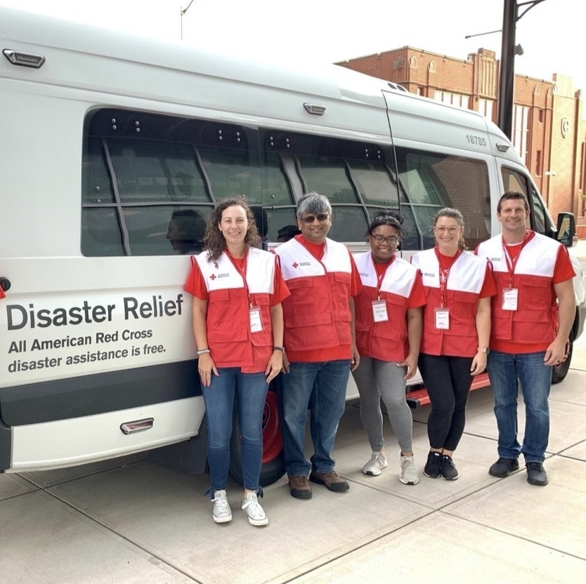 Legrand employees in front of an American Red Cross van