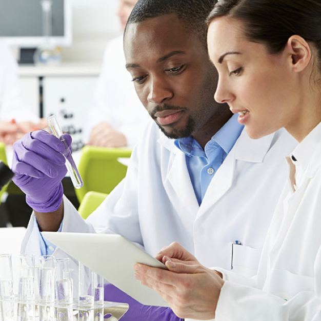 Scientist looking at lab reports on an iPad