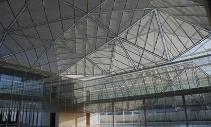 Sky lights with shades over large commercial building interior