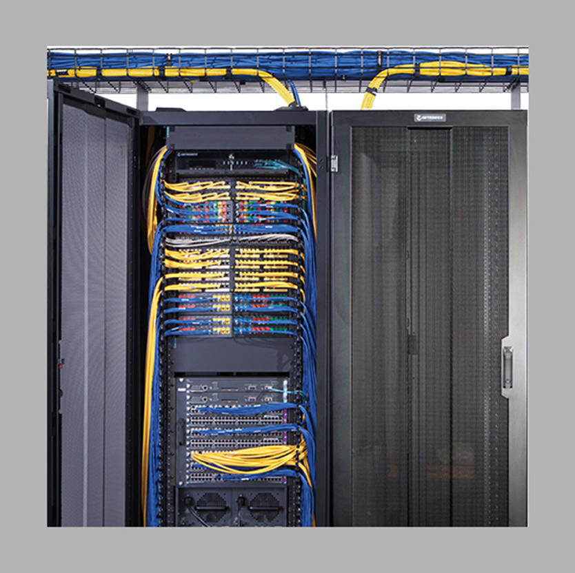 Legrand blue and yellow cables in a data center rack space and enclosure
