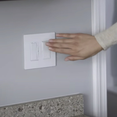 hand extended to turn on white switch