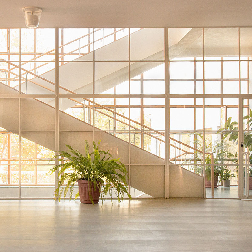 Commercial lobby space with staircase and large windows