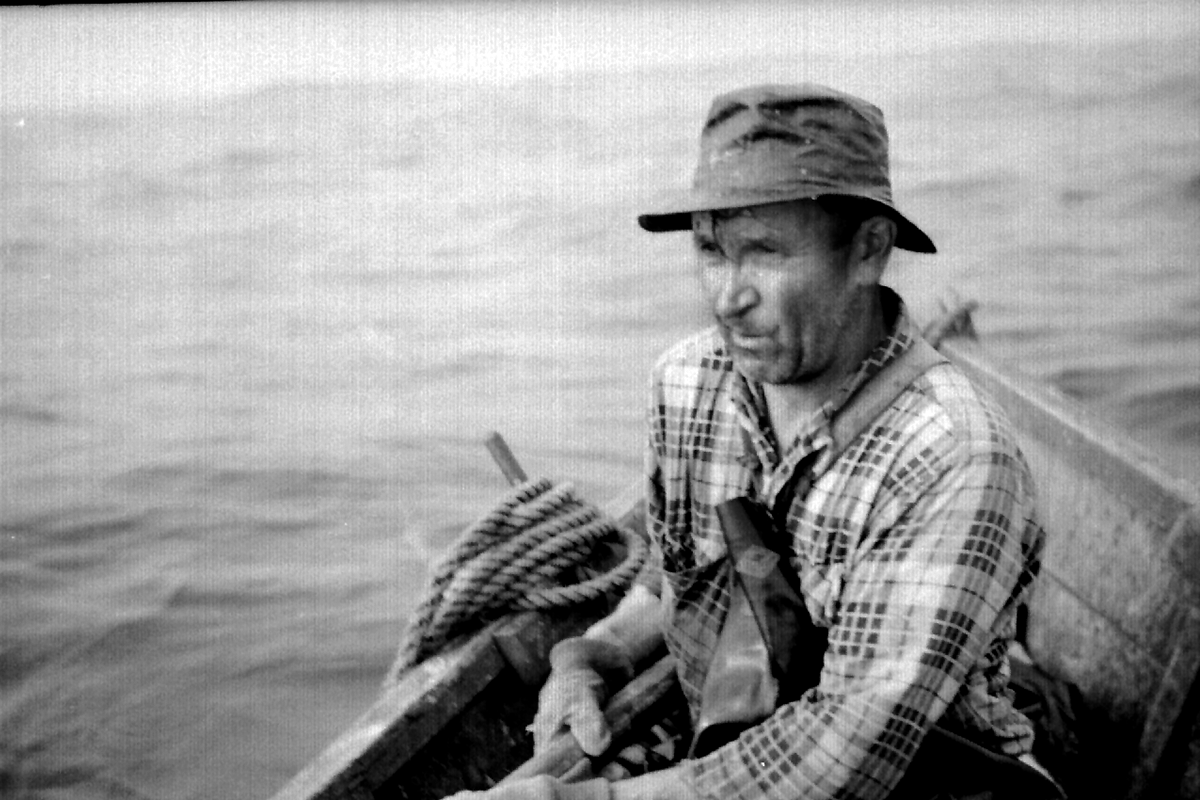 fisherman rowing a dory