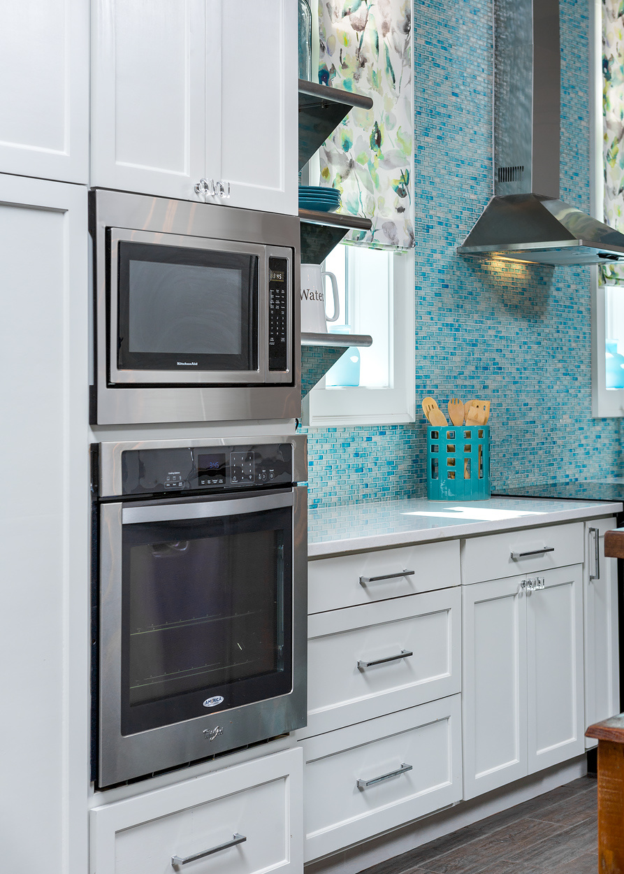 Inexpensive appliances are built in to the cabinetry for a high-end look.