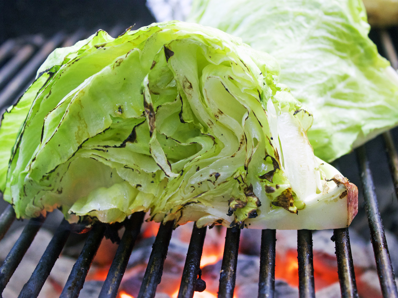 Grill the iceberg lettuce to enhance the flavor.