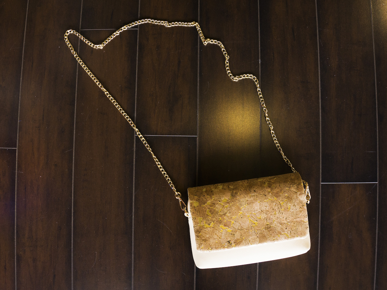 Pair the olive dress above with this cork accent bag, $64
