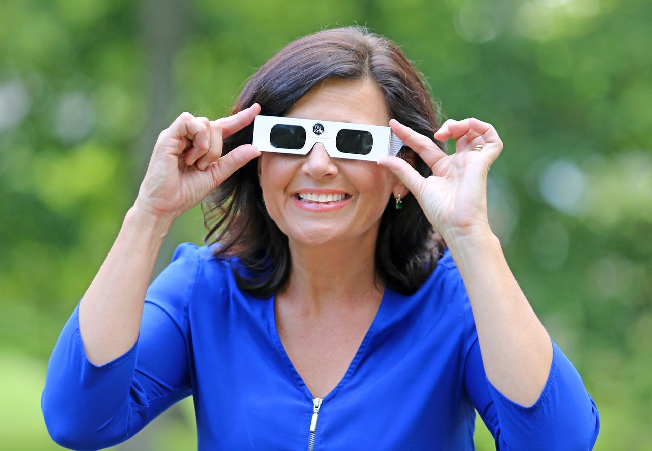 Janet's never without a hefty supply of eclipse safety glasses, and she's quick to share them with anyone she meets.