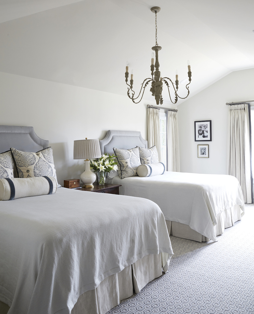With its soft, velvet upholstered headboards and hand-painted euro shams, this guest bedroom provides ample sleeping for this home away from home. Libby found vintage press photos of Coach Bear Bryant and other historical images that add personality and local flavor throughout the home.