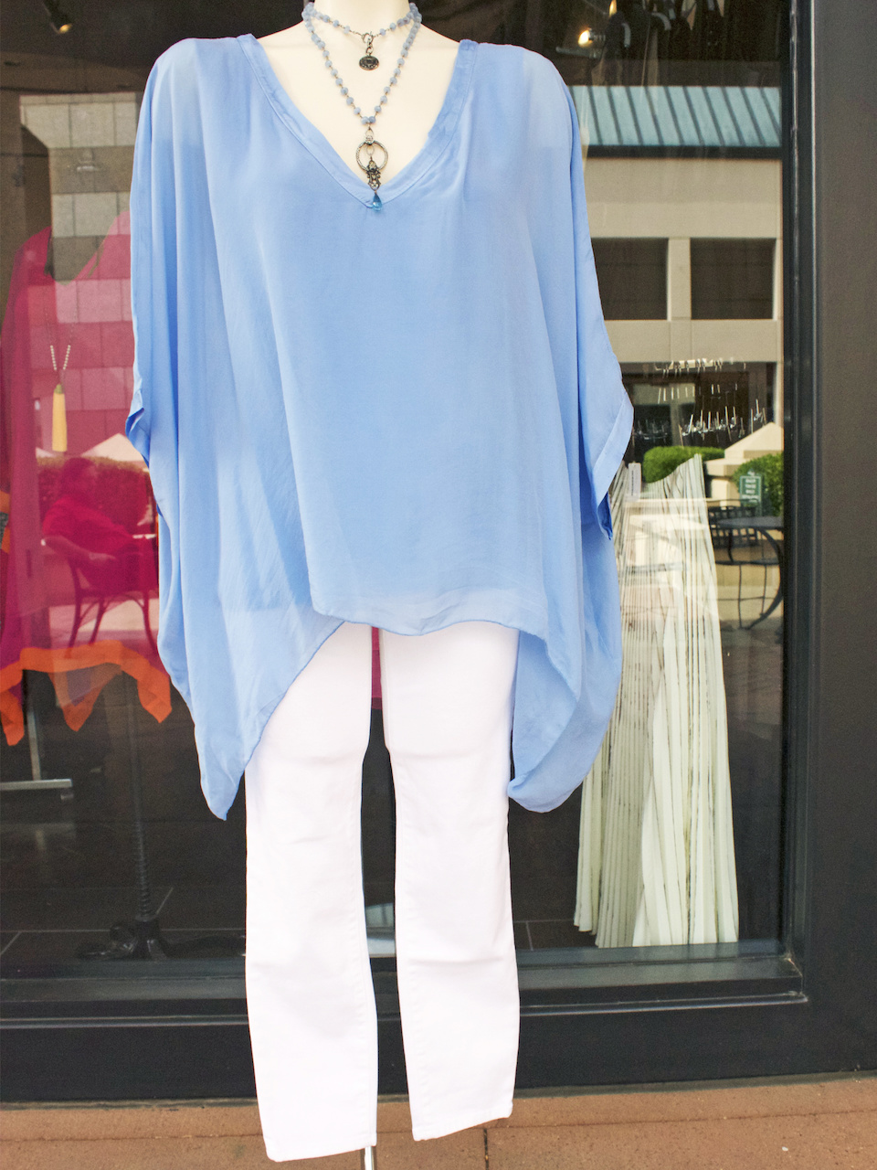 A classic summer look - a flowy, ice-blue top with a pair of white jeans