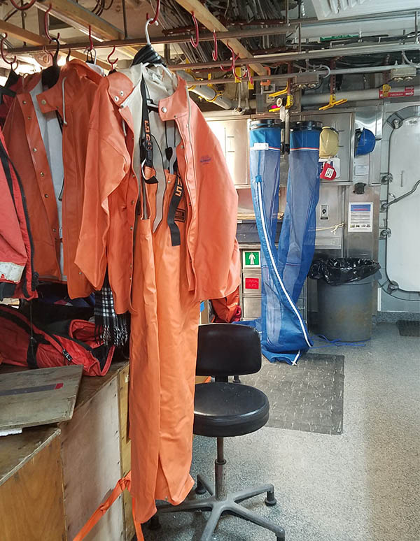 We wear these Gründens when working on deck. The blue net in back is a CalVET sampler, a pair of nets equipped with very fine mesh to collect tiny marine organisms.