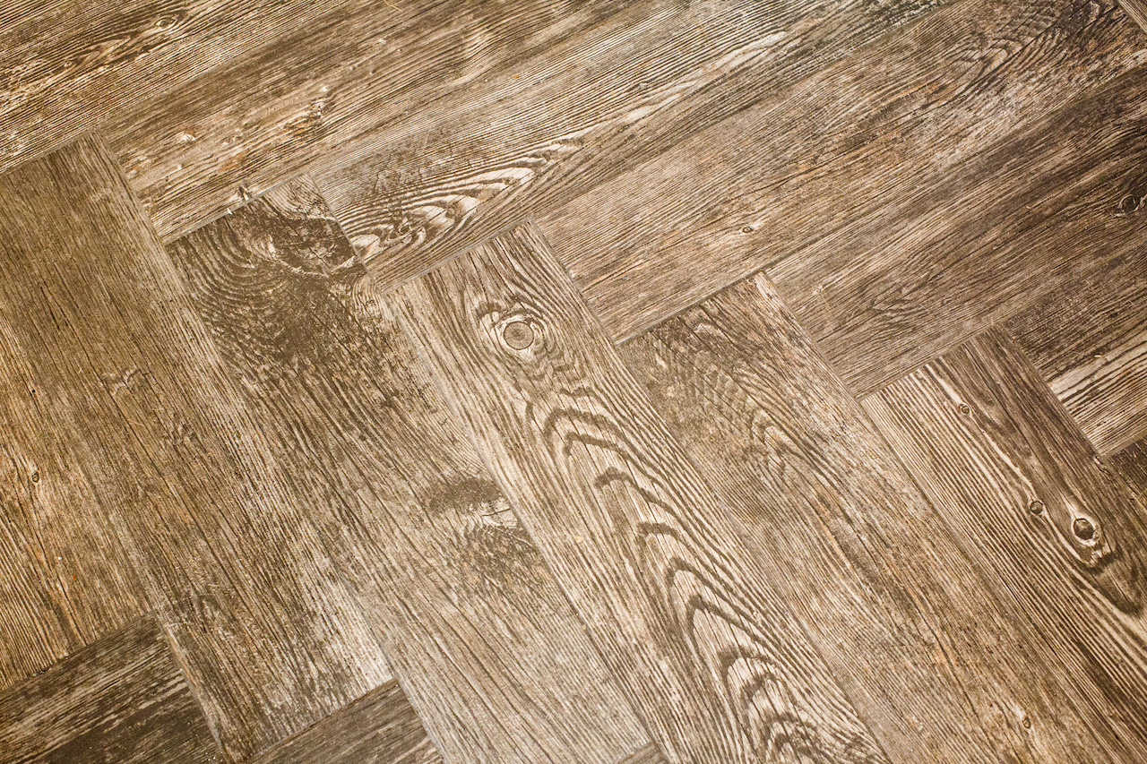 The wood floor's chevron pattern adds another dash of interest to the kitchen and dining area.