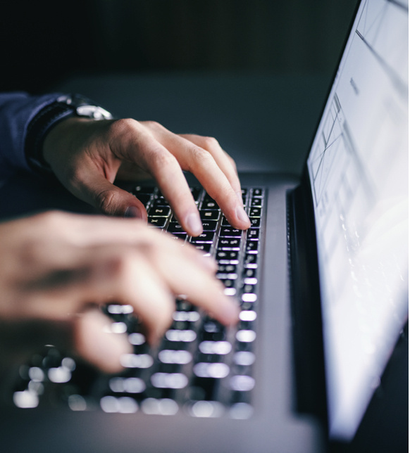 Hands on laptop computer keyboard