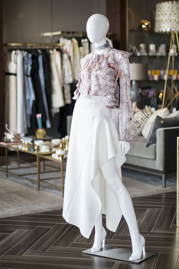 From 20twelve: Cherry blossom top by Giambattista Valli, $1,965; Kaya Midi skirt by Solace London, $520; ARox necklace, $248