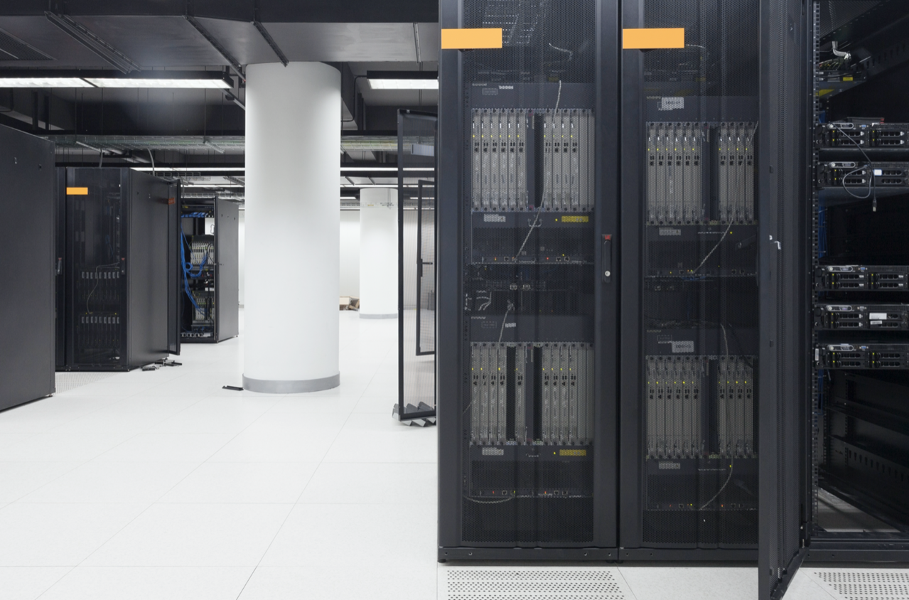 Desktop image of data center with black racks and enclosures