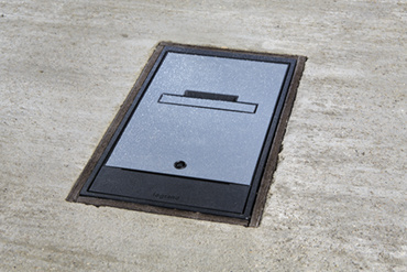 Wiremold Outdoor Ground Box in concrete